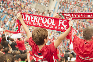 Liverpool FC fan holding scarf